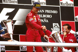 Race winner Michael Schumacher, Ferrari celebrates on the podium with team boss Jean Todt