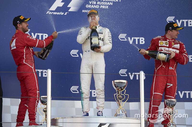 Race winner Valtteri Bottas, Mercedes AMG F1, second place Sebastian Vettel, Ferrari, Third place Ki