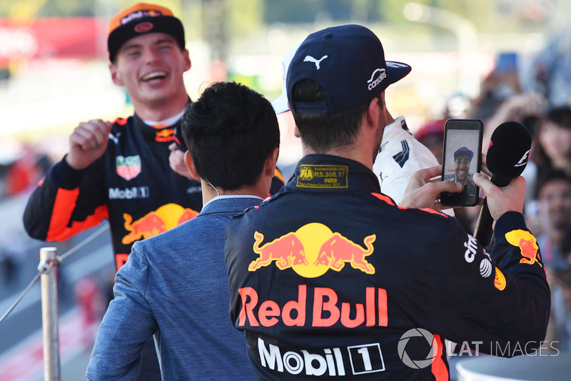 Daniel Ricciardo, Red Bull Racing celebrates with his phone on the podium