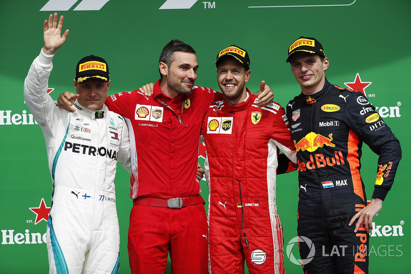 Sebastian Vettel, Ferrari, celebrates on the podium with Valtteri Bottas, Mercedes AMG F1 and Max Verstappen, Red Bull Racing