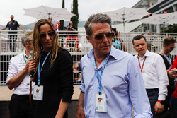 Actor Hugh Grant arrives in the paddock with wife Anna Elisabet Bernstein