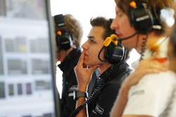 Lando Norris, McLaren, watches the session from the garage