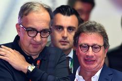 Серджо Маркіонне , генеральний директор FIAT та Луіс Кері Камілері, глава правління Philip Morris