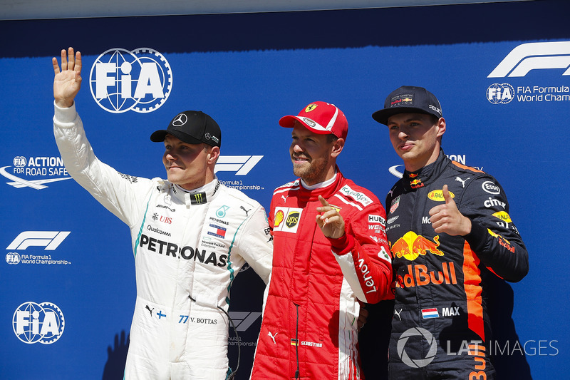 Sebastian Vettel, Ferrari, celebrates pole position ahead of Valtteri Bottas, Mercedes AMG F1 and Ma