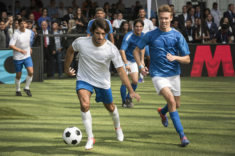 Carlos Sainz Jr., Scuderia Toro Rosso and Daniil Kvyat, Scuderia Toro Rosso performs during a soccer match at Plaza Carso rooftop