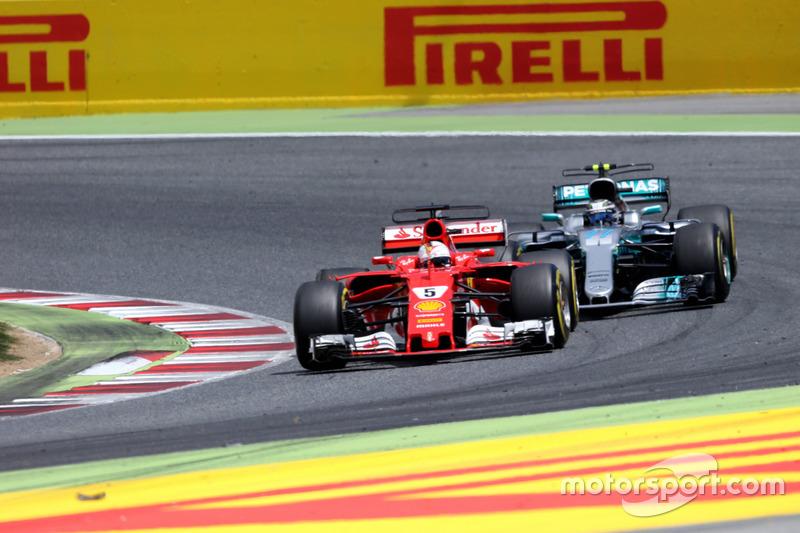 Sebastian Vettel, Ferrari SF70H and Valtteri Bottas, Mercedes-Benz F1 W08 battle for position