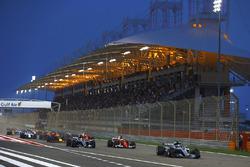 Valtteri Bottas, Mercedes AMG F1 W08, leads Sebastian Vettel, Ferrari SF70H, and Lewis Hamilton, Mercedes AMG F1 W08, at the start of the race