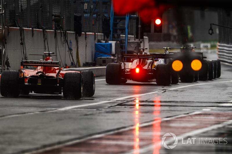Nico Hulkenberg, Renault Sport F1 Team RS17, Sebastian Vettel, Ferrari SF70H, in the pit lane