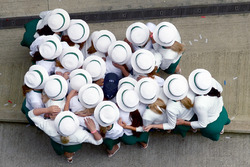Grid Girls huddle around Race winner Lewis Hamilton, Mercedes AMG F1