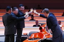Yusuke Hasegawa, Senior Managing Officer, Honda, Zak Brown, Executive Director of McLaren Technology Group, Eric Boullier, Racing Director, McLaren, and presenter Simon Lazenby toast the McLaren MCL32