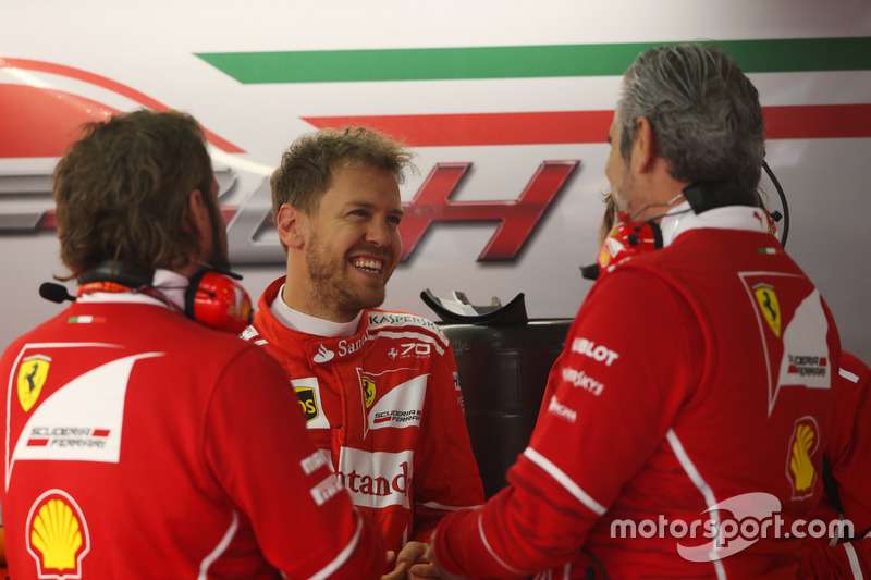 Sebastian Vettel, Ferrari, talks to Maurizio Arrivabene, Team Principal, Ferrari and a team mate