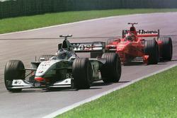Mika Hakkinen, McLaren MP4/13 leads Michael Schumacher, Ferrari F300