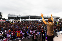 Fernando Alonso, McLaren, acknowledges the crowd from the stage