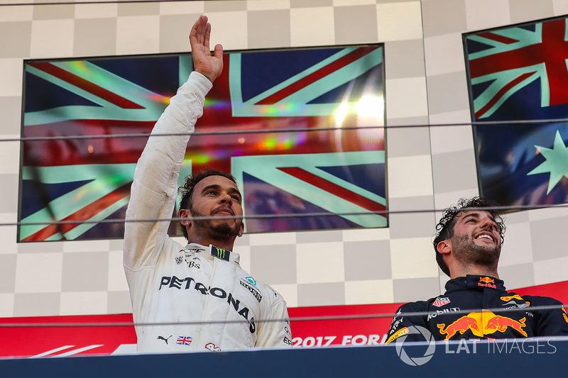 Race winner Lewis Hamilton, Mercedes AMG F1 celebrates on the podium alongside Daniel Ricciardo, Red Bull Racing