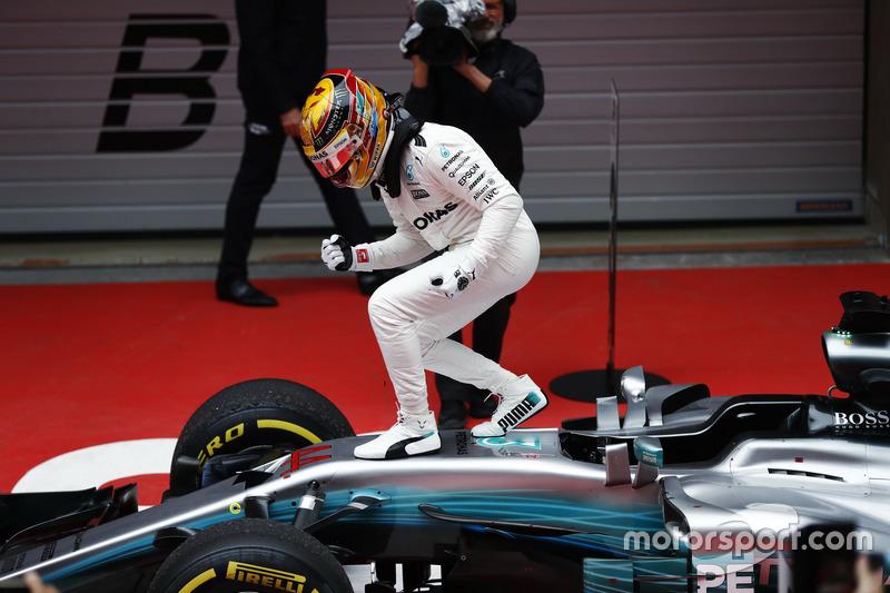Lewis Hamilton, Mercedes AMG, celebrates victory in parc ferme