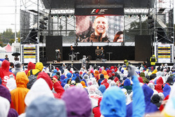 Jenson Button, McLaren, makes an appearance on stage to talk to fans
