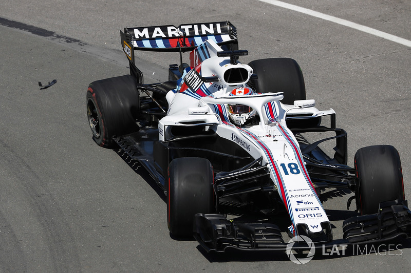 Lance Stroll, Williams FW41, drives with a damaed wheel in FP1