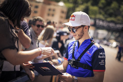 Pierre Gasly, Scuderia Toro Rosso signs autographs for the fans