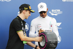 Professional Road Cyclist Simon Yates poses for a picture with Lewis Hamilton, Mercedes AMG F1, after qualifying