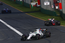 Felipe Massa, Williams FW40, leads Romain Grosjean, Haas F1 Team VF-17