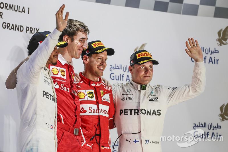 Lewis Hamilton, Mercedes AMG, second place, Matteo Togninalli, Chief Race Engineer, Ferrari, Sebastian Vettel, Ferrari, race winner, Valtteri Bottas, Mercedes, third place, on the podium