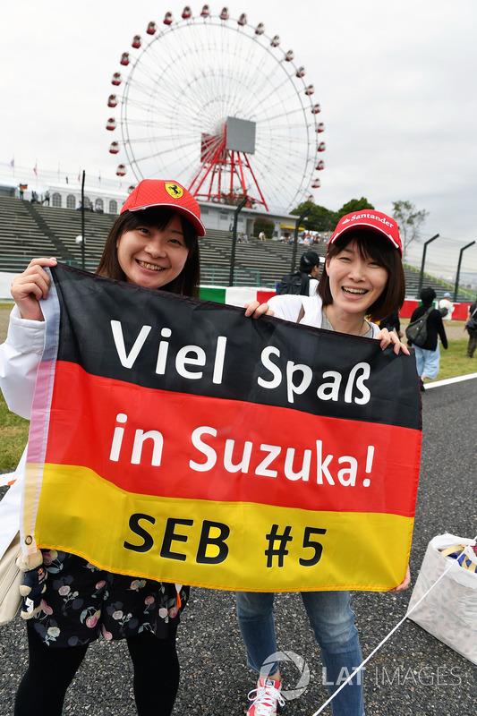 Sebastian Vettel, Ferrari fans and banner