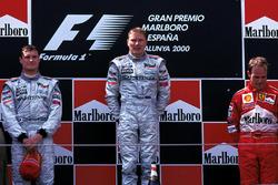 Podium: race winner Mika Hakkinen, McLaren, second place David Coulthard, McLaren, third place Rubens Barrichello, Ferrari