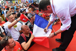 Eric Boullier, McLaren Racing Director signs autographs for the fans