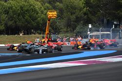 Lewis Hamilton, Mercedes-AMG F1 W09 leads at the start of the race as Sebastian Vettel, Ferrari SF71H hits Valtteri Bottas, Mercedes-AMG F1 W09