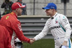 Valtteri Bottas, Mercedes AMG F1, congratulates Sebastian Vettel, Ferrari, on pole