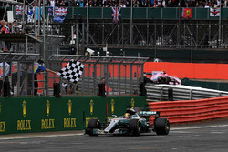 Race winner Lewis Hamilton, Mercedes-Benz F1 W08  takes the chequered flag