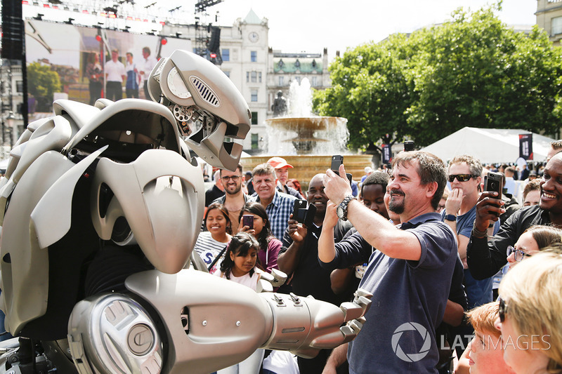 A robotic performer mingles, the crowds