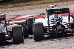 Fernando Alonso, McLaren MP4-31 and Felipe Massa, Williams FW38 touch wheels