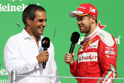 (L to R): Juan Pablo Montoya, on the podium with Sebastian Vettel, Ferrari