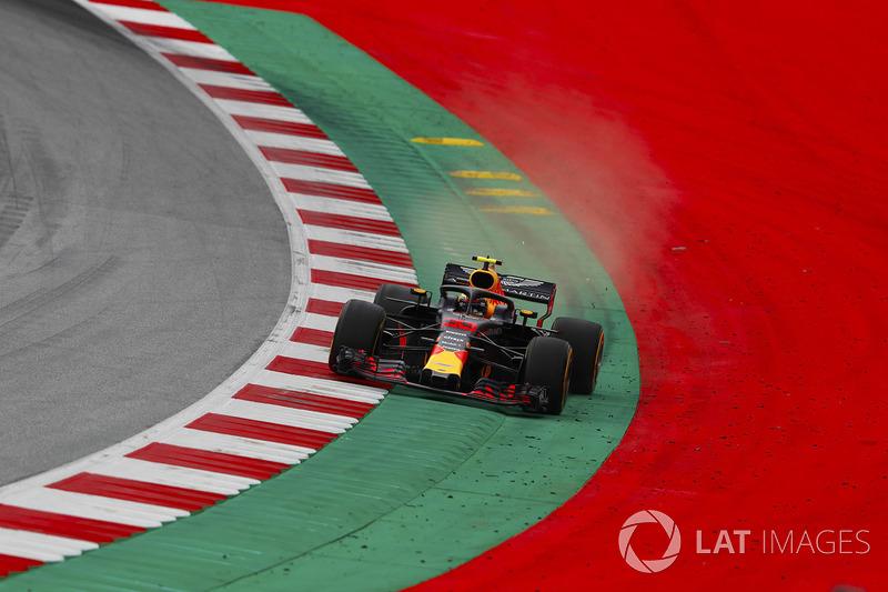 Max Verstappen, Red Bull Racing RB14, runs wide over a kerb