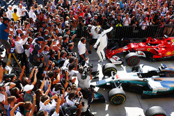 Lewis Hamilton, Mercedes AMG F1 W08, jumps from his car in Parc Ferme after winning the race