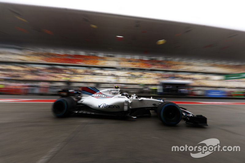 Lance Stroll, Williams FW40, in the pit lane
