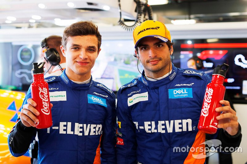 Lando Norris, McLaren, Carlos Sainz Jr., McLaren with Coca-Cola bottles