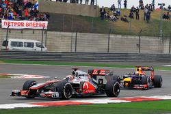 Jenson Button, McLaren MP4-27 leads Sebastian Vettel, Red Bull Racing RB8