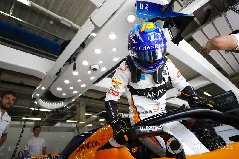 Fernando Alonso, McLaren, climbs in to his cockpit