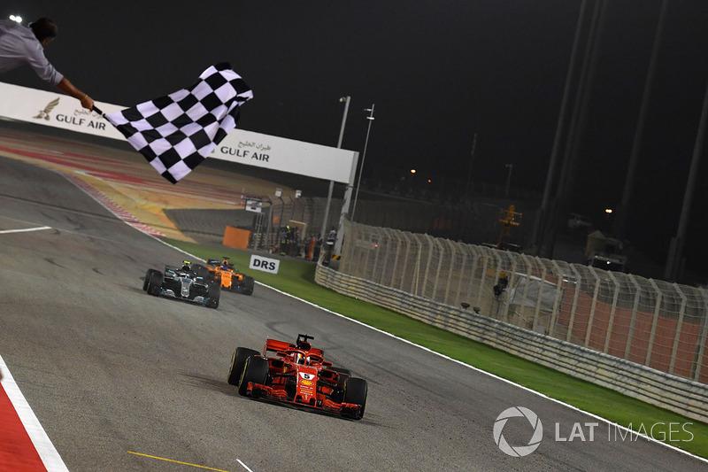 Race winner Sebastian Vettel, Ferrari SF71H crosses the line and takes the chequered flag