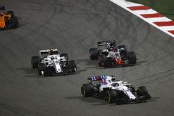 Lance Stroll, Williams FW41 Mercedes, leads Charles Leclerc, Sauber C37 Ferrari, Romain Grosjean, Haas F1 Team VF-18 Ferrari, and Stoffel Vandoorne, McLaren MCL33 Renault