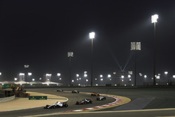 Lance Stroll, Williams FW41 Mercedes, leads Romain Grosjean, Haas F1 Team VF-18 Ferrari, Charles Leclerc, Sauber C37 Ferrari, Stoffel Vandoorne, McLaren MCL33 Renault, and the remainder of of the field on the formation lap