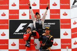 Podium: race winner Pastor Maldonado, Williams, second place Fernando Alonso, Ferrari, and third place Kimi Raikkonen, Lotus F1