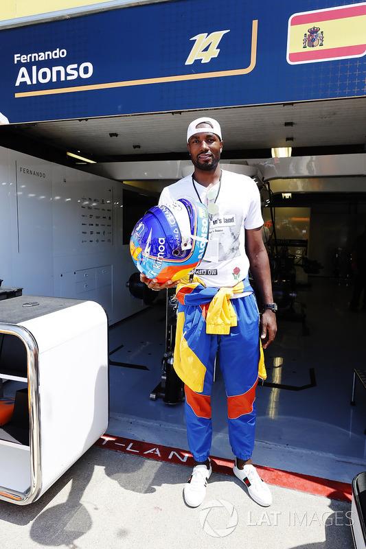 Serge Ibaka, Toronto Raptors NBA player with the helmet of Fernando Alonso, McLaren.