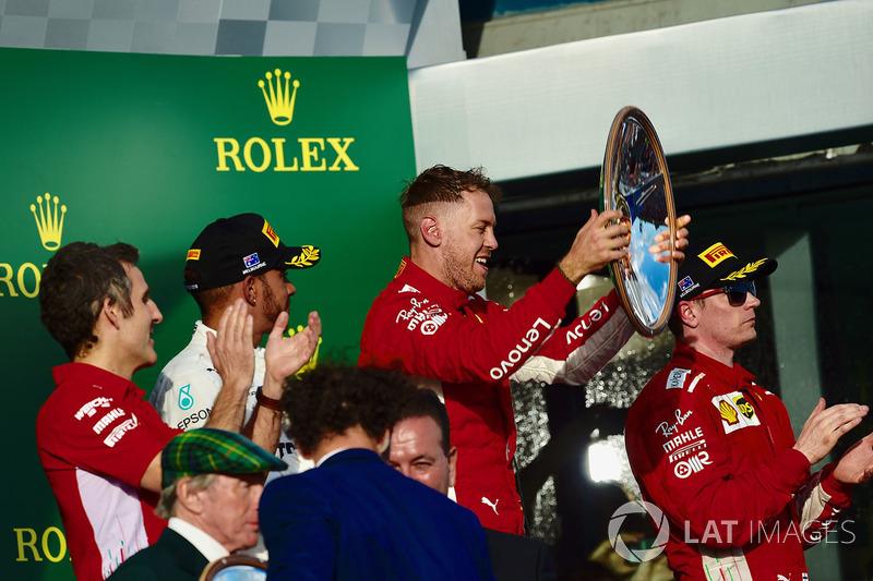 Lewis Hamilton, Mercedes-AMG F1, Sebastian Vettel, Ferrari and Kimi Raikkonen, Ferrari celebrate on the podium