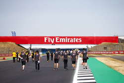 Kevin Magnussen, Haas F1 Team, and colleagues walk the track