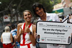 Tag Heuer promotional models hold a board for Kimi Raikkonen, Ferrari