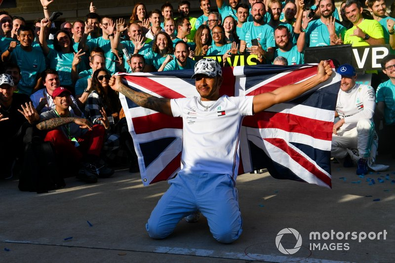 Lewis Hamilton, Mercedes AMG F1, 2nd position, celebrates with his team after securing his 6th drivers title