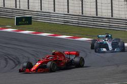 Kimi Raikkonen, Ferrari SF71H, leads Lewis Hamilton, Mercedes AMG F1 W09